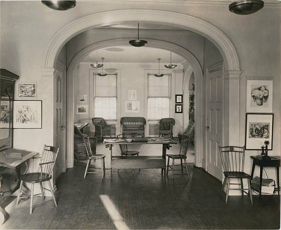 The Whitney Studio club. A homey interior with chairs and tables, and art on the walls