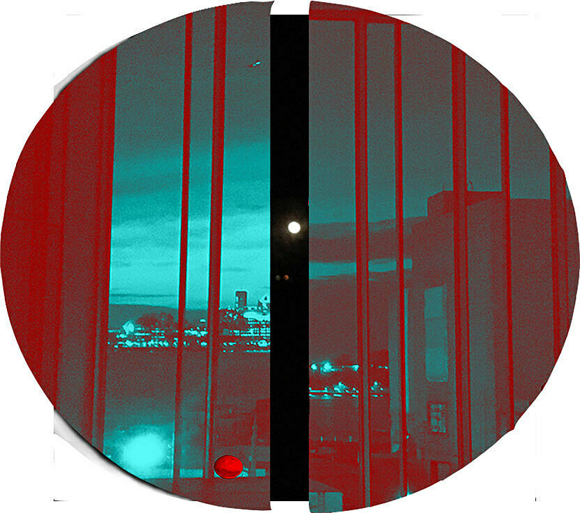 Distorted image of city skyline through window in vivid red and aqua