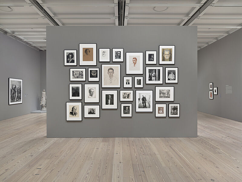 Grey, salon-style wall, in gallery