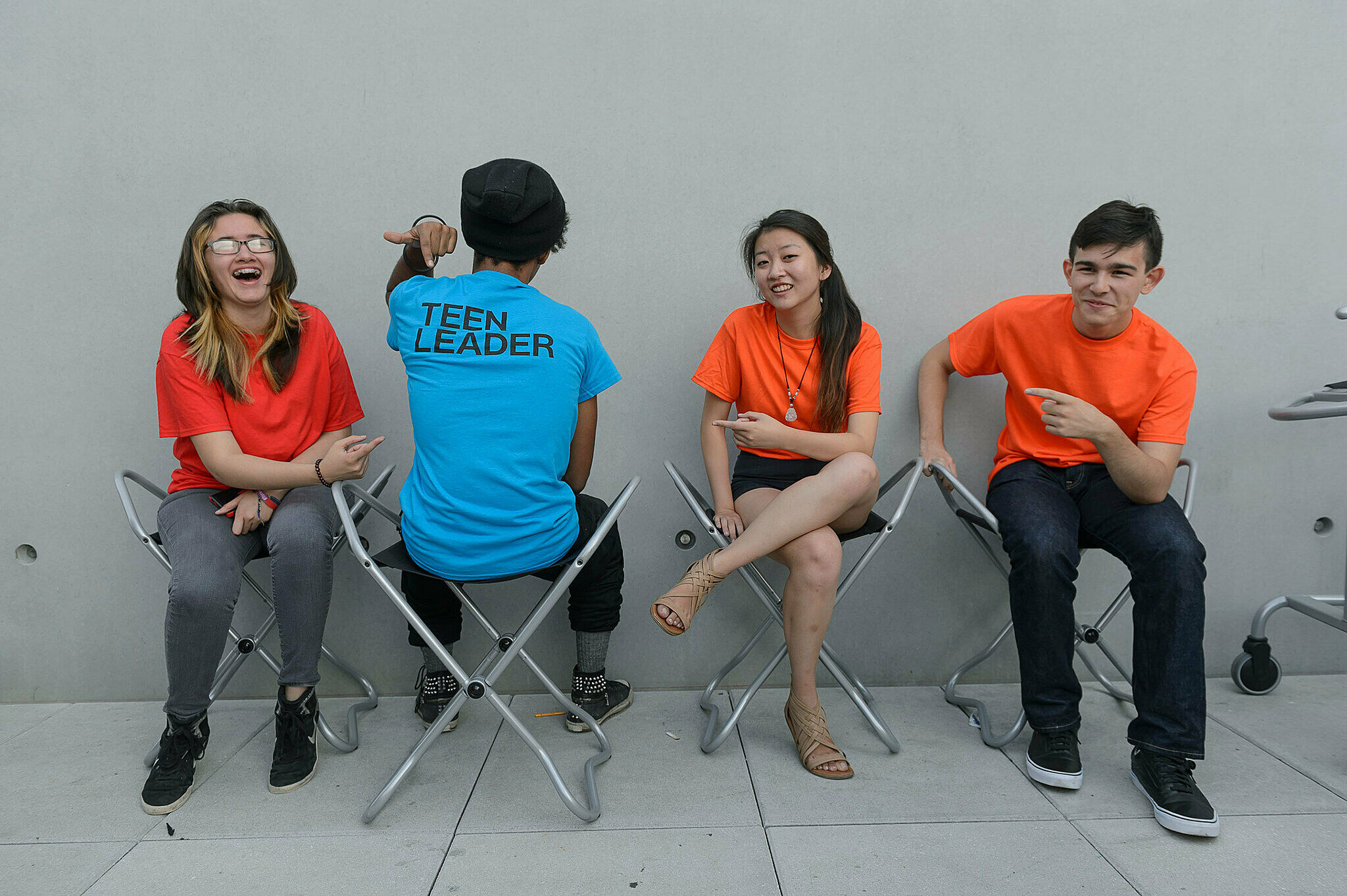 Four teens sitting on stools at the Whitney.