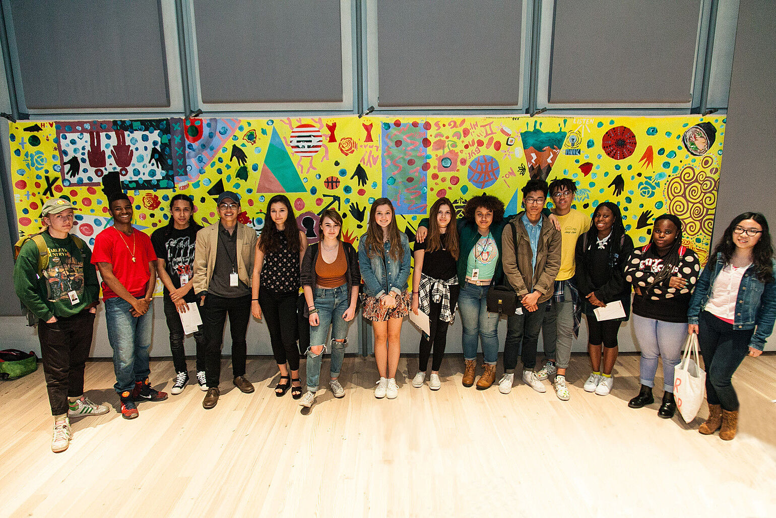 YI Artists pose with collaborative painting made with artist Nina Chanel Abney. Photograph by Andrew Kist.