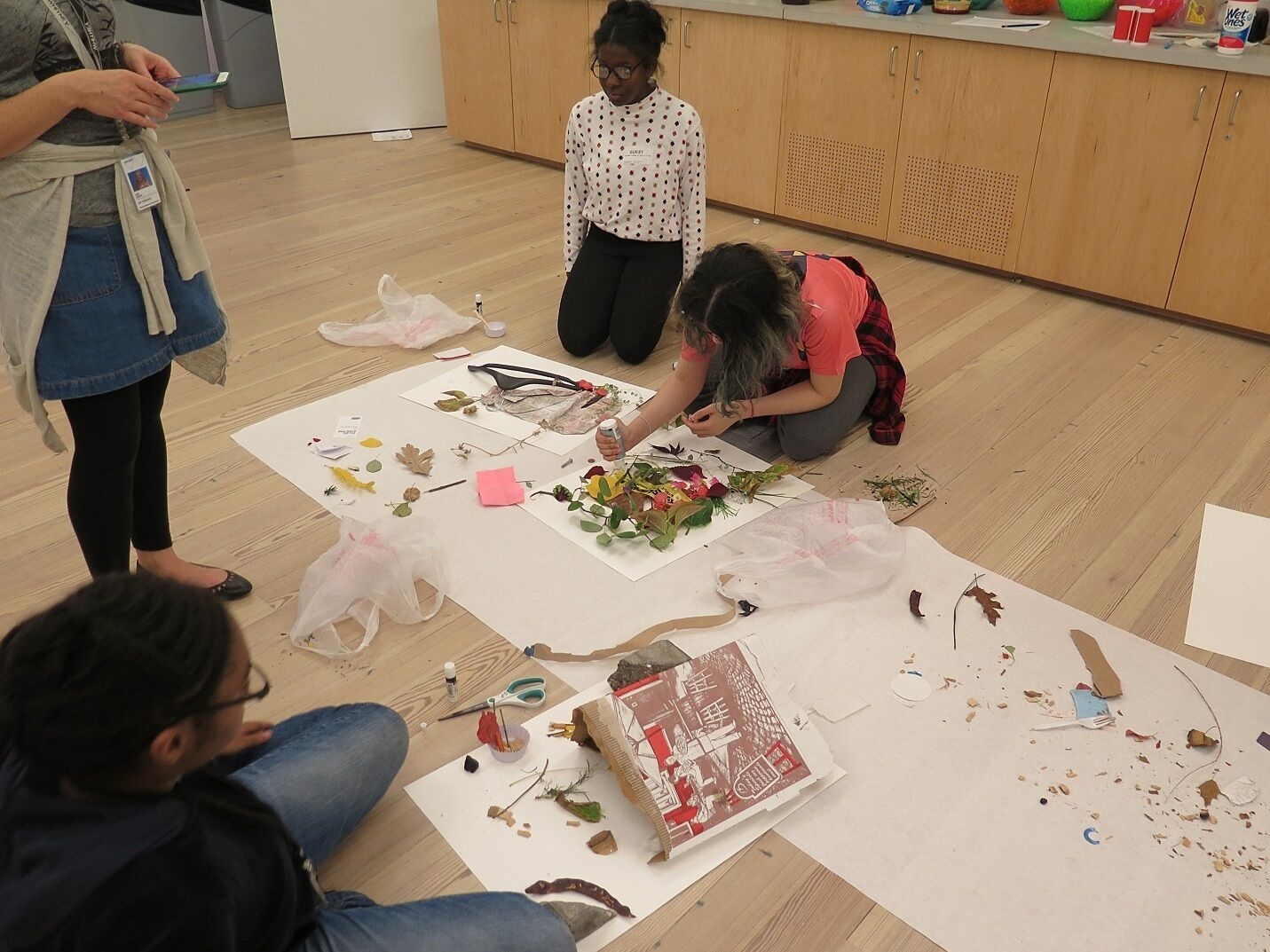 Students making an art project with flower