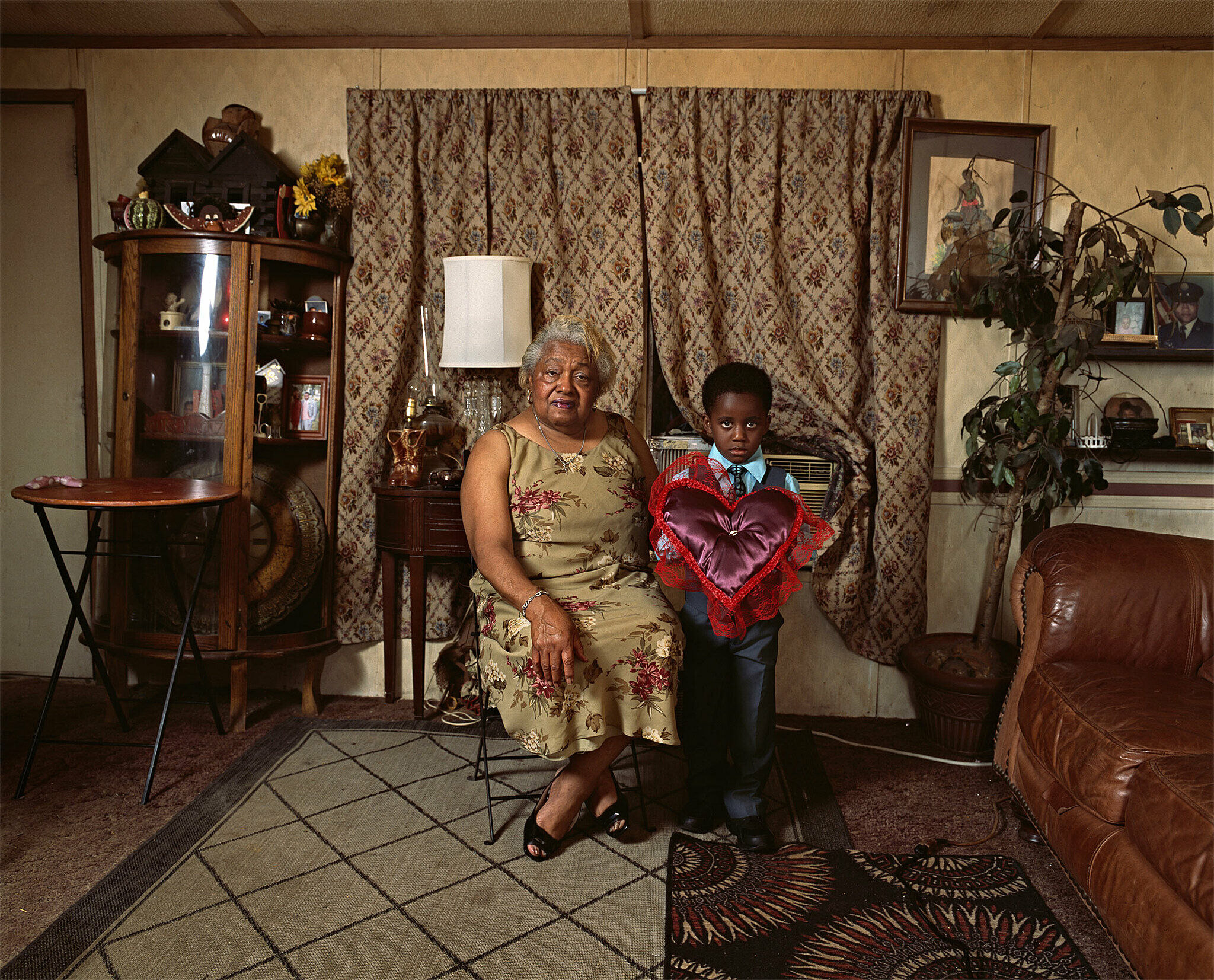 Portrait of a woman and a young boy in a living room