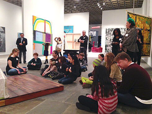 families sit inside gallery of paintings