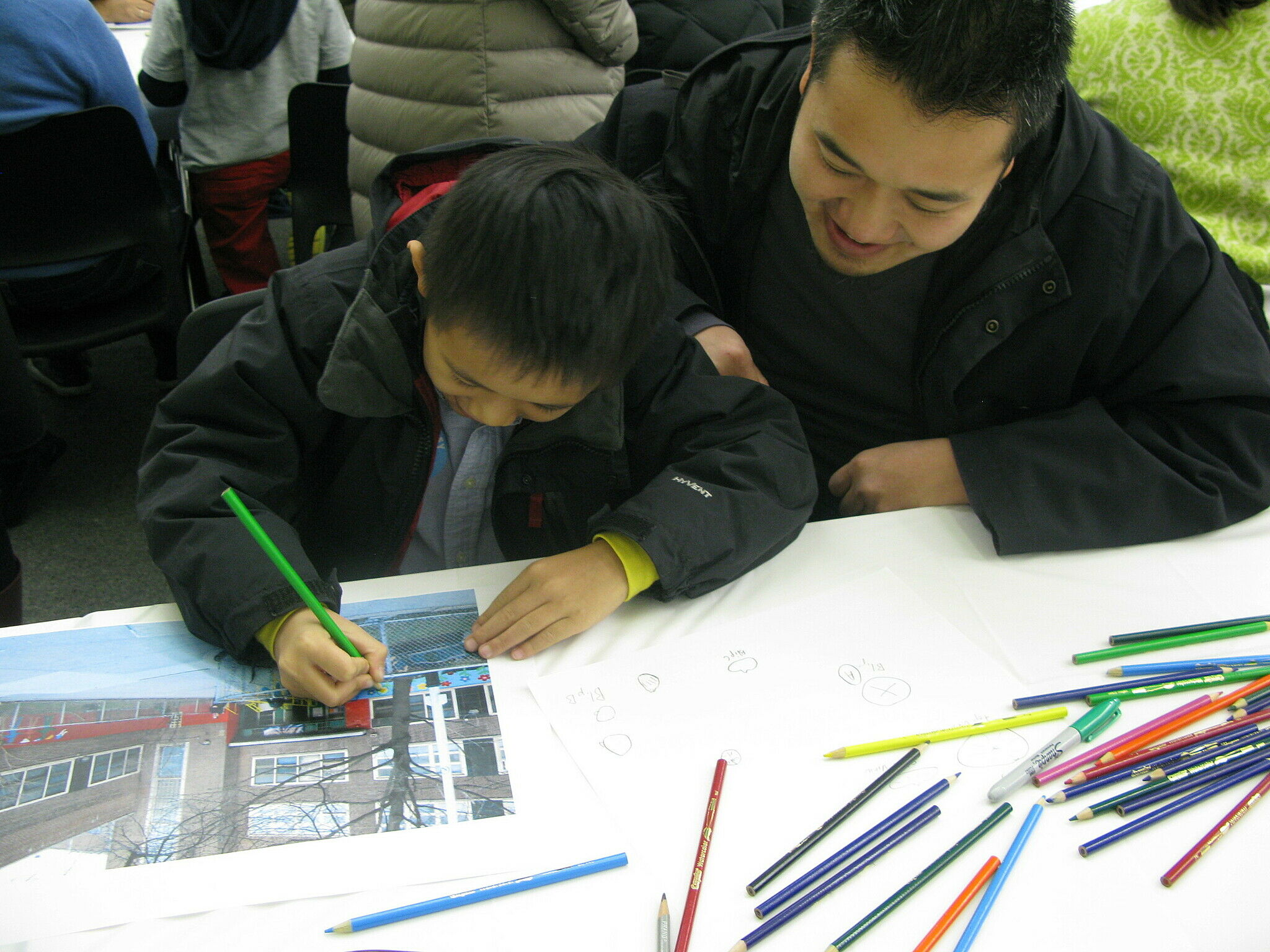 student and father working on artwork