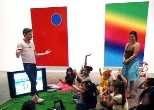 cory explaining art to children in gallery