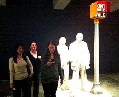 teachers standing next to statues