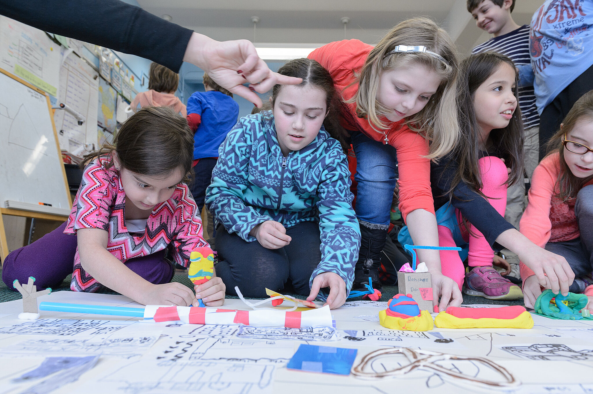 Children working on large map.