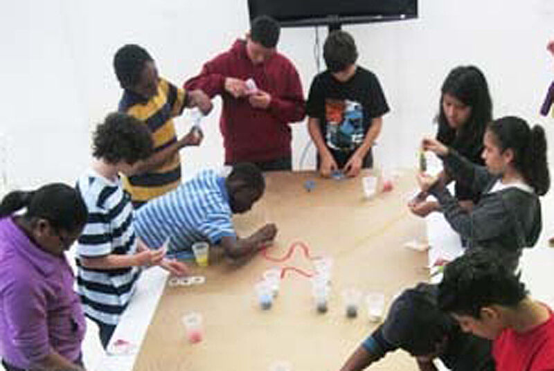 Students at table working on crafts.