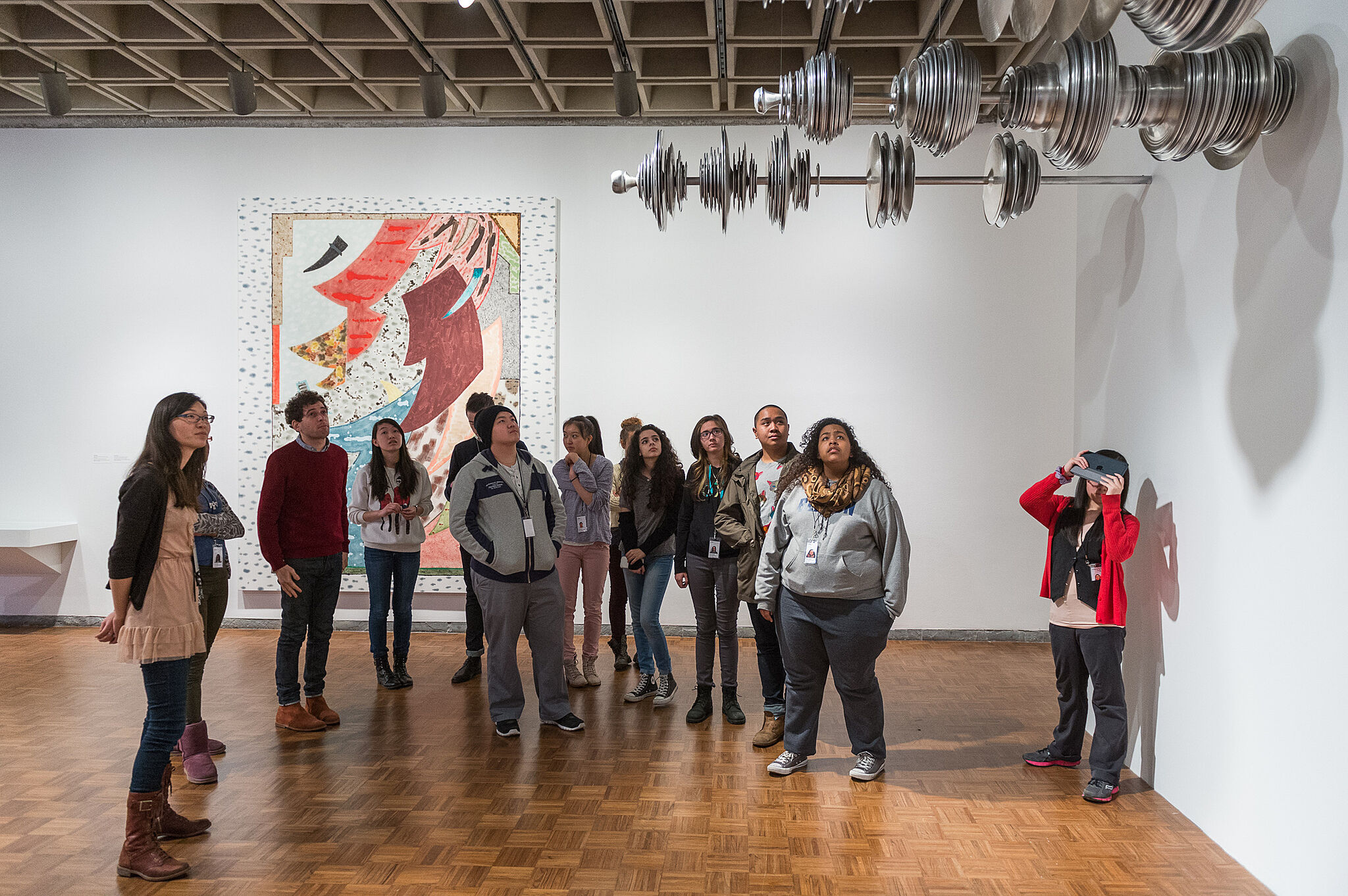 Teens take a tour of the Biennial exhibit with an artist.