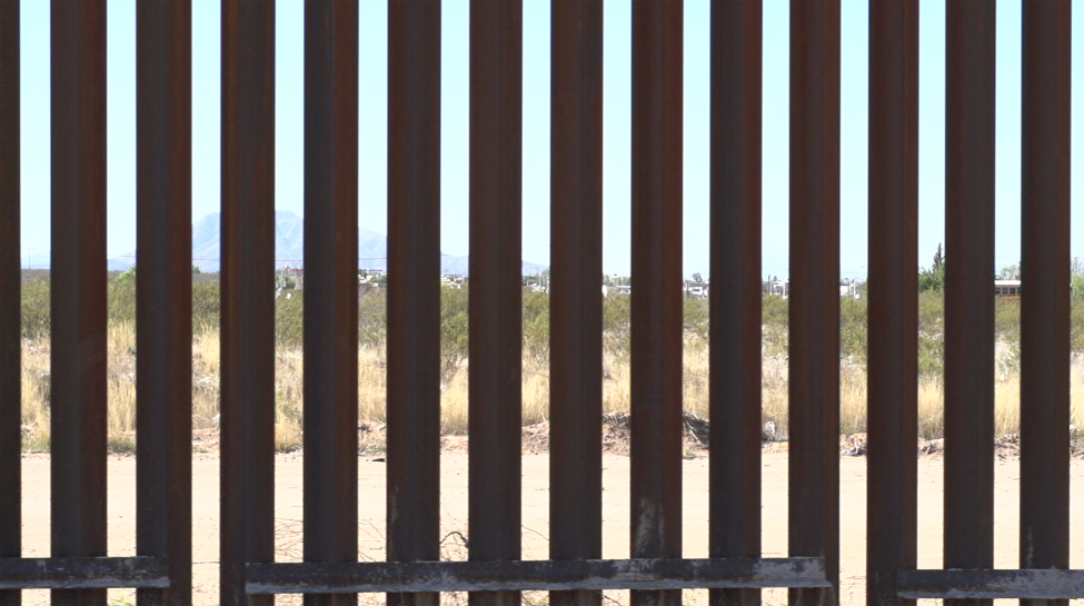 Video still of a brown fence.