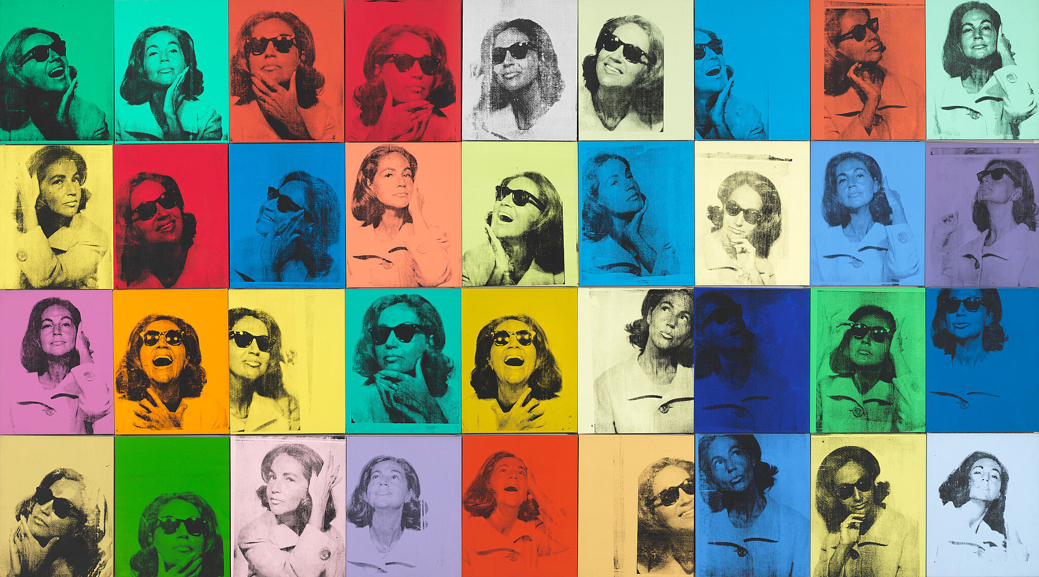 Colorful artwork of woman faces by Andy Warhol.