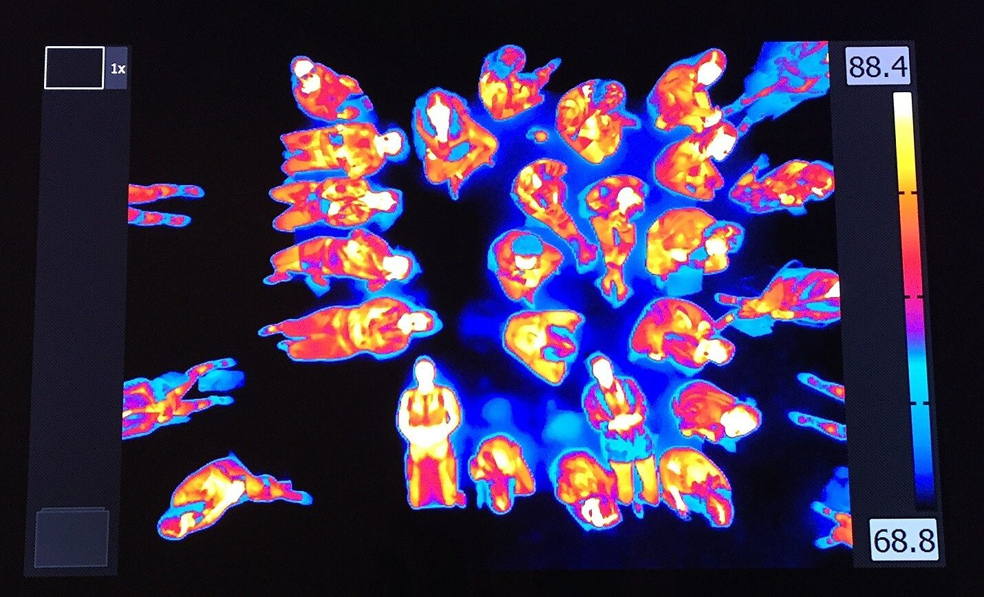 Thermal scan image of people.