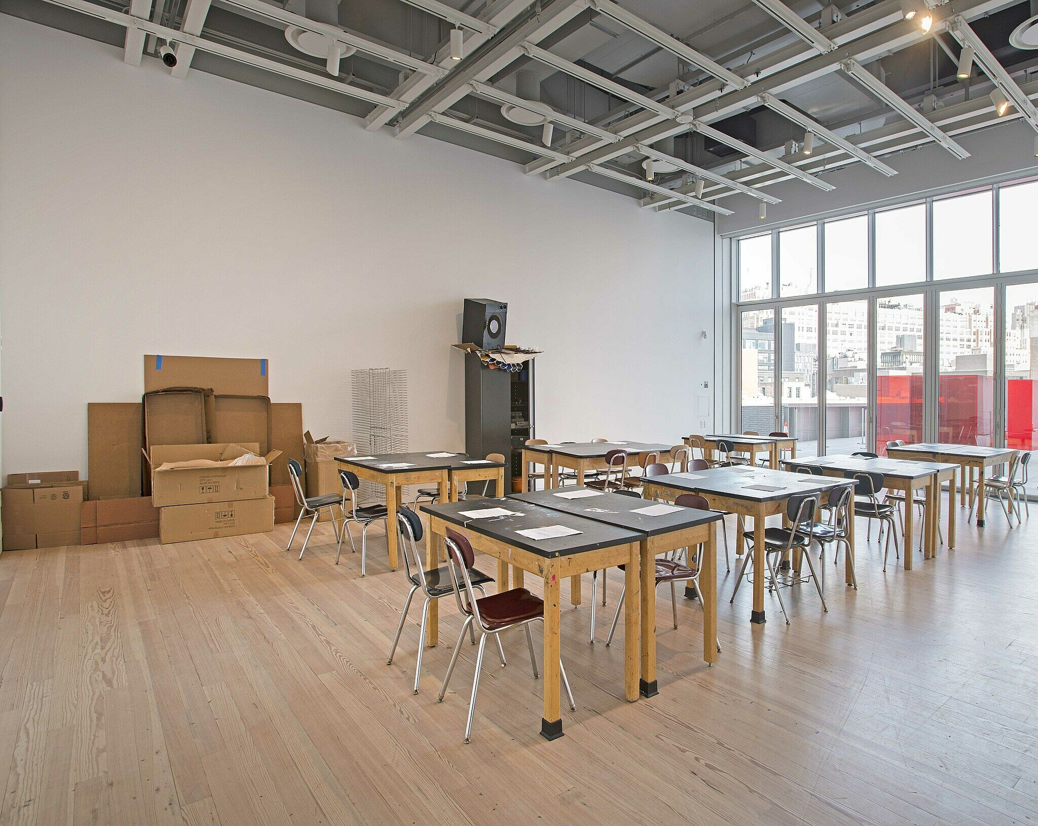 Classroom desks and chairs in a gallery.