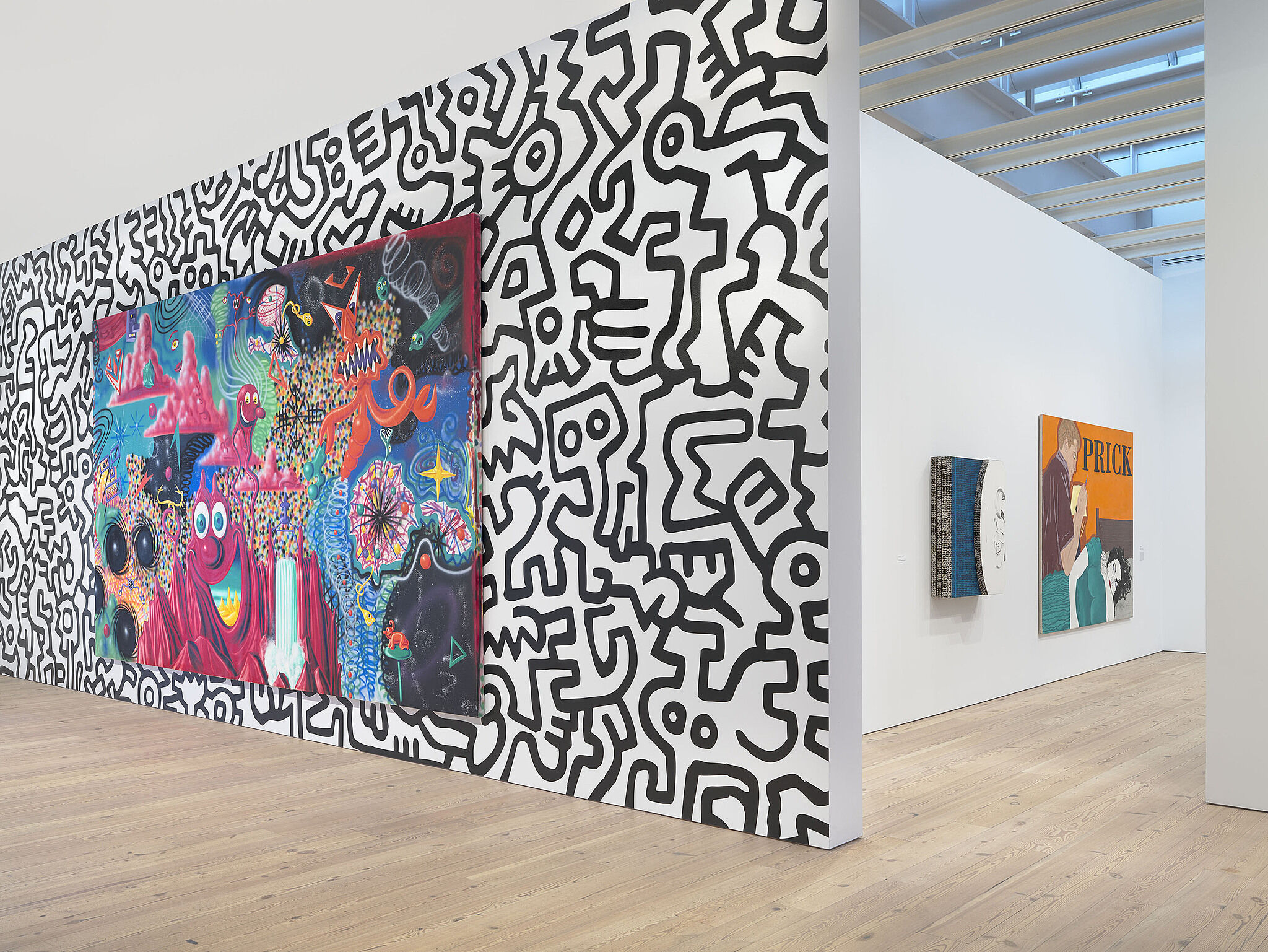 Scharf painting on a wall with Haring background.
