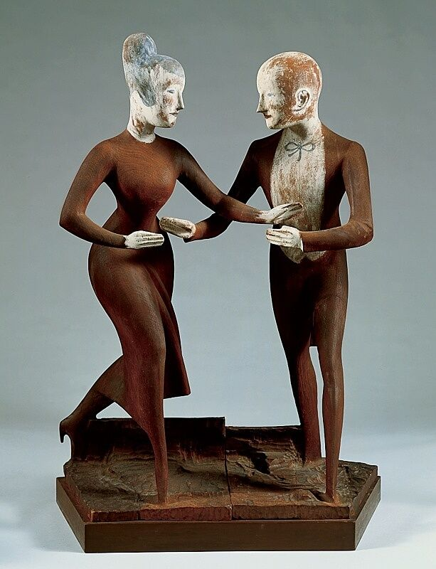 A sculpture of a man and woman dancing.