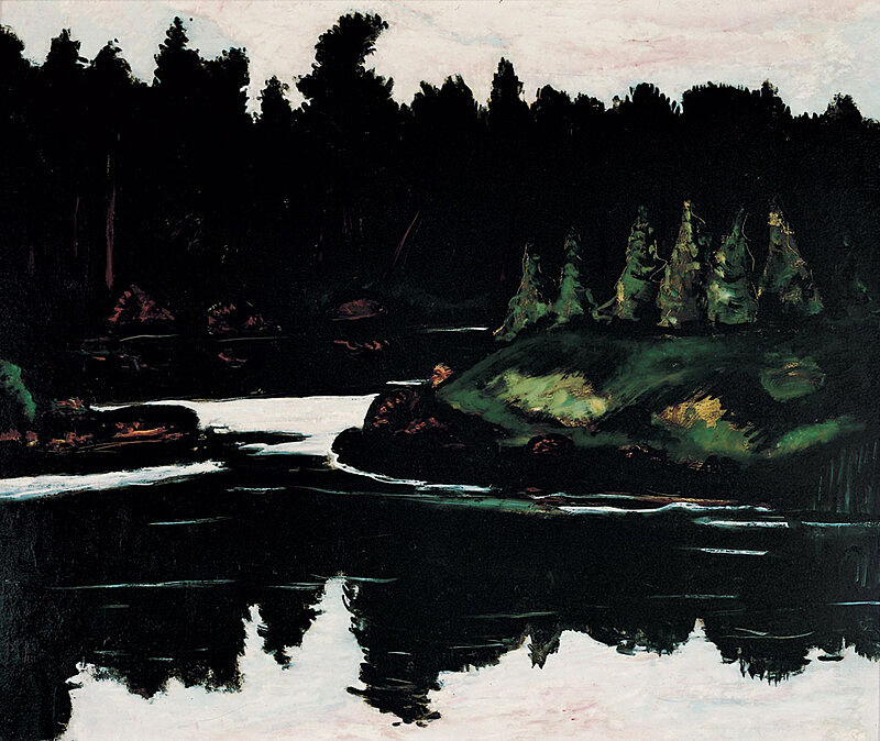 A river scene with a reflection of trees.