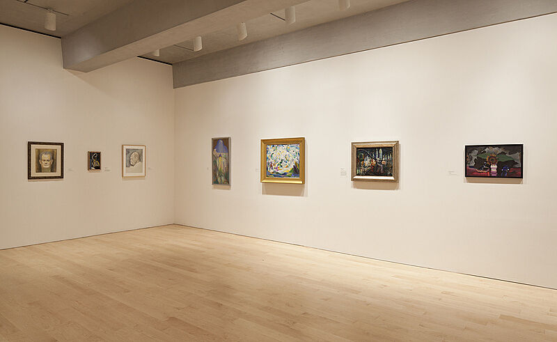 Paintings on the wall of the Whitney Museum.