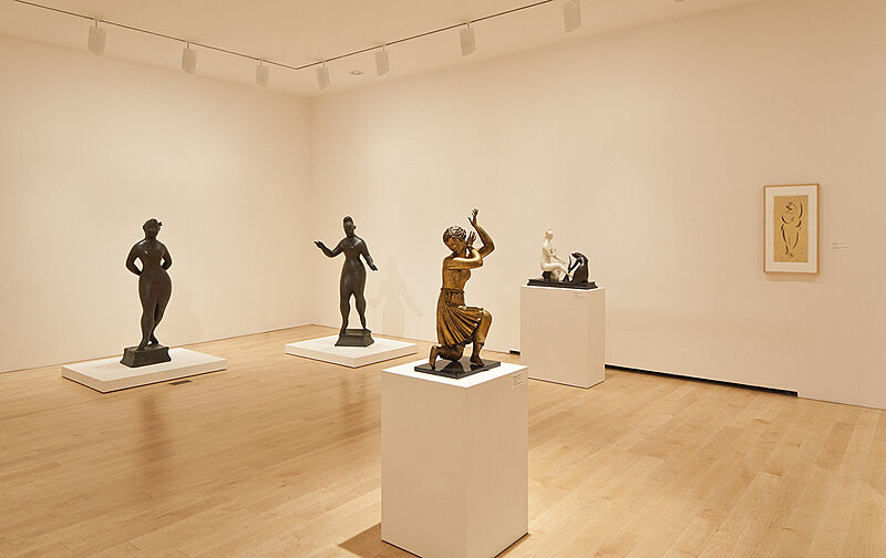 Four sculptures in a gallery with white walls.