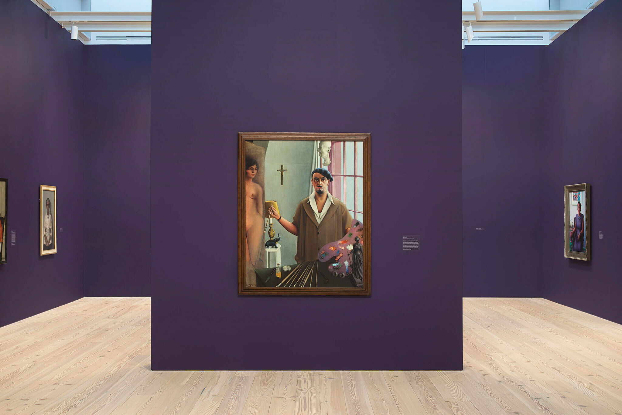 An art gallery with purple walls.