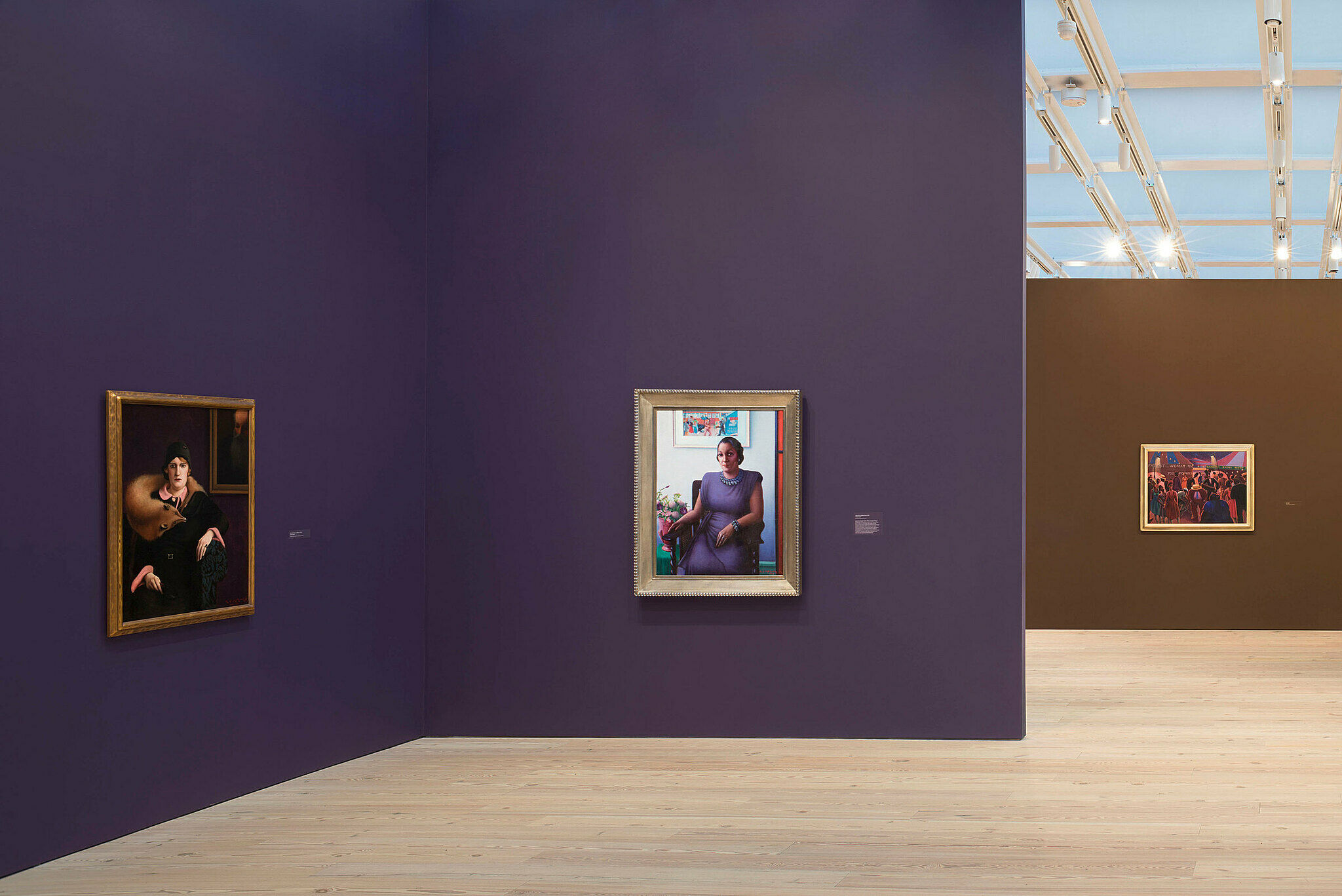 Paintings by Archibald Motley in a gallery at the Whitney Museum.