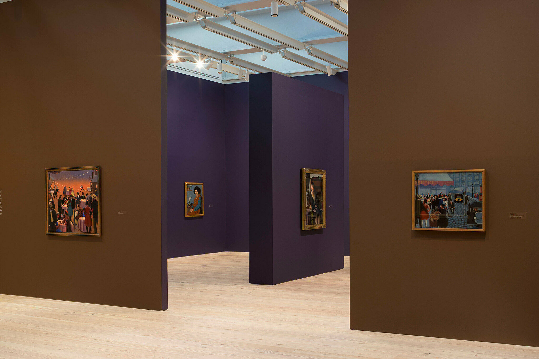A view of the art gallery with paintings by Archibald Motley.