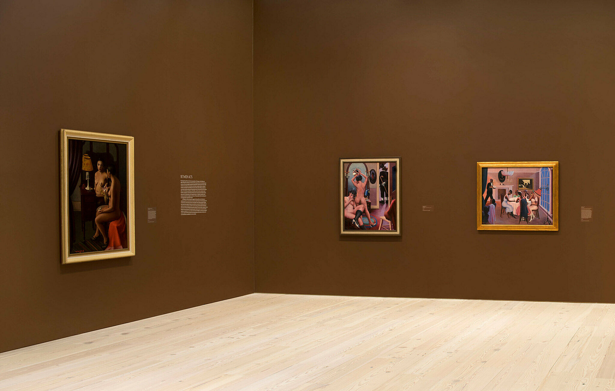Three paintings on the walls at a gallery in the Whitney Museum.