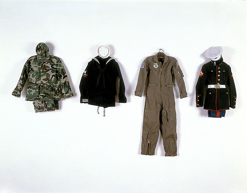 Four military uniforms from the Army, Navy, Air Force and Marines.