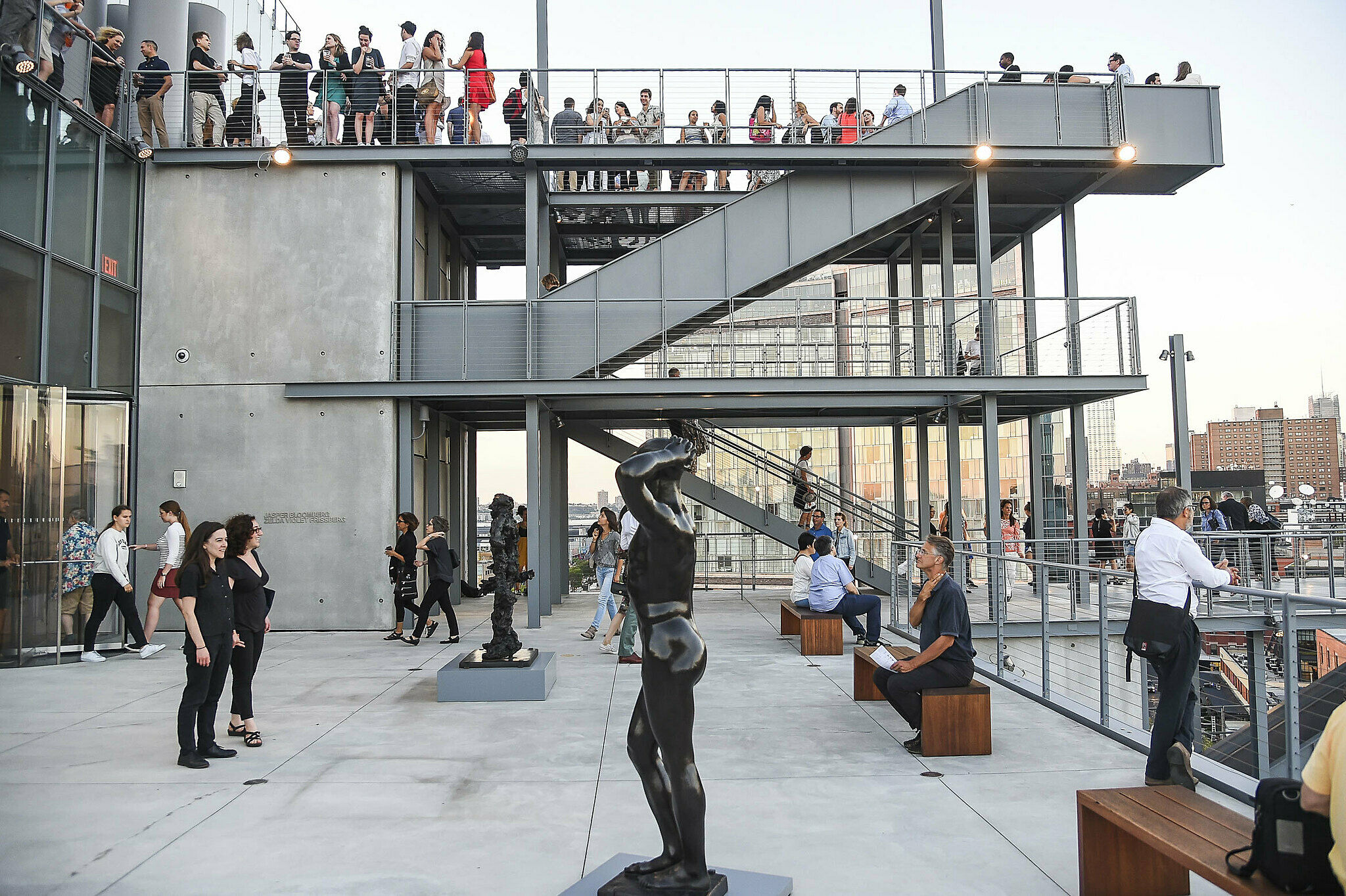 People on the outdoor galleries during Member Night on August 3, 2016.