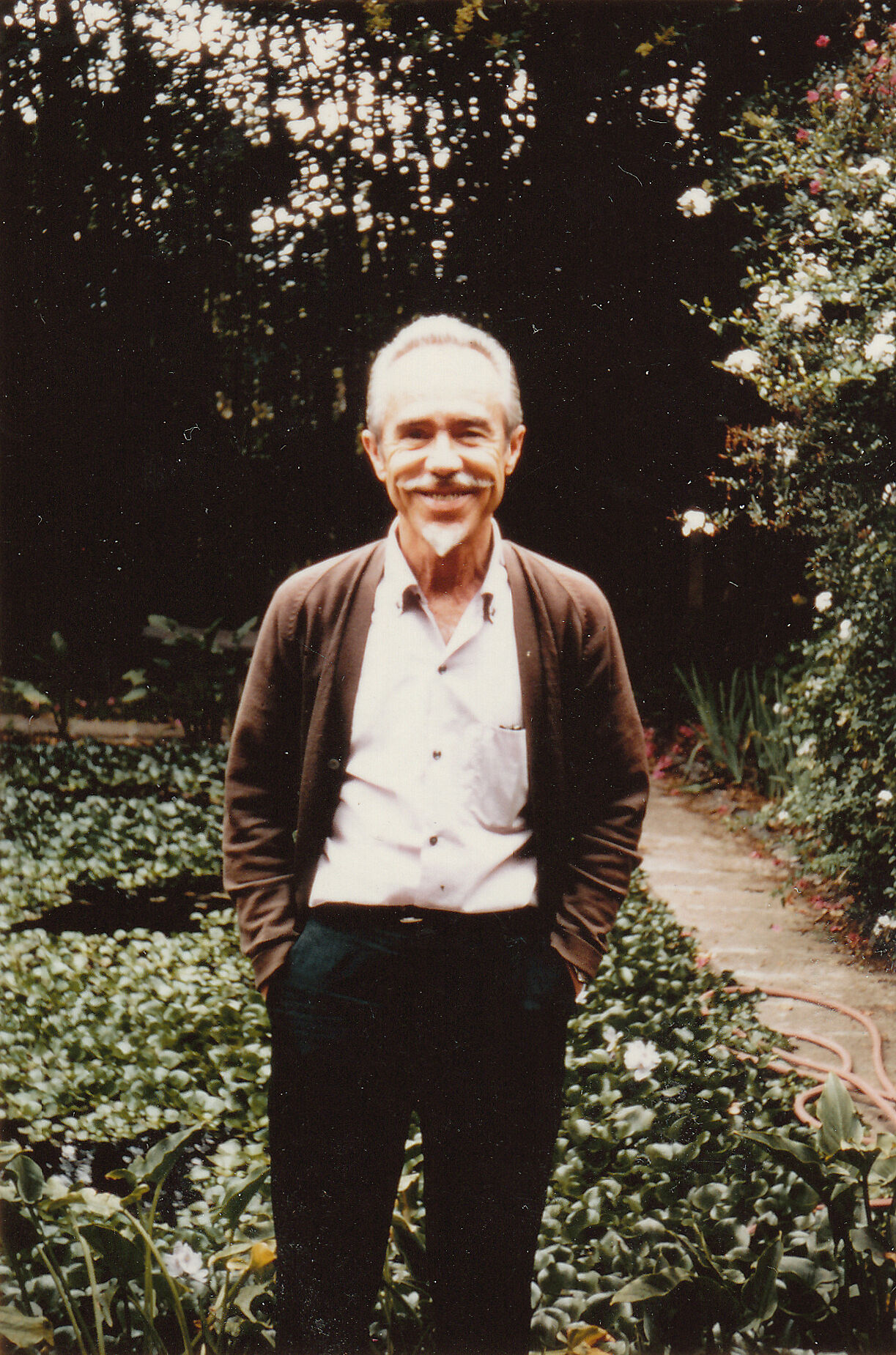 The composer Conlon Nancarrow wearing a sweater in his garden.