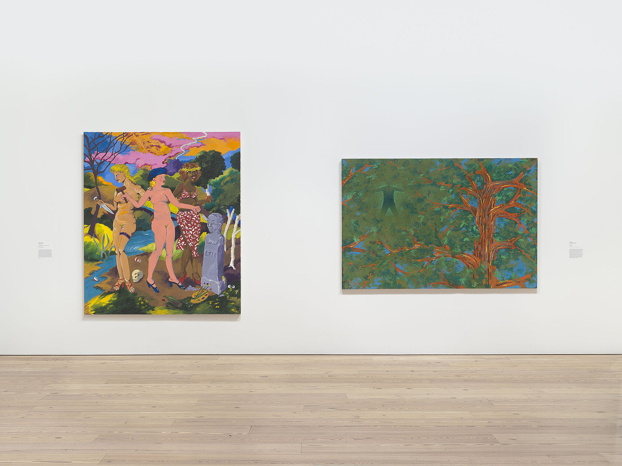 Two colorful paintings hanging side by side.