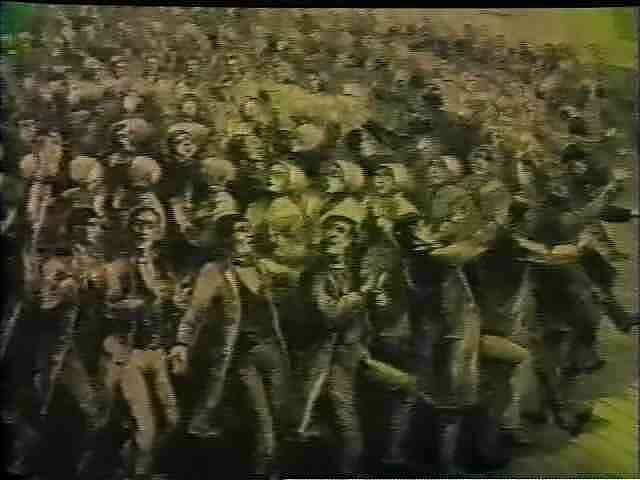 Video still of a crowd from a work by Dan Graham.