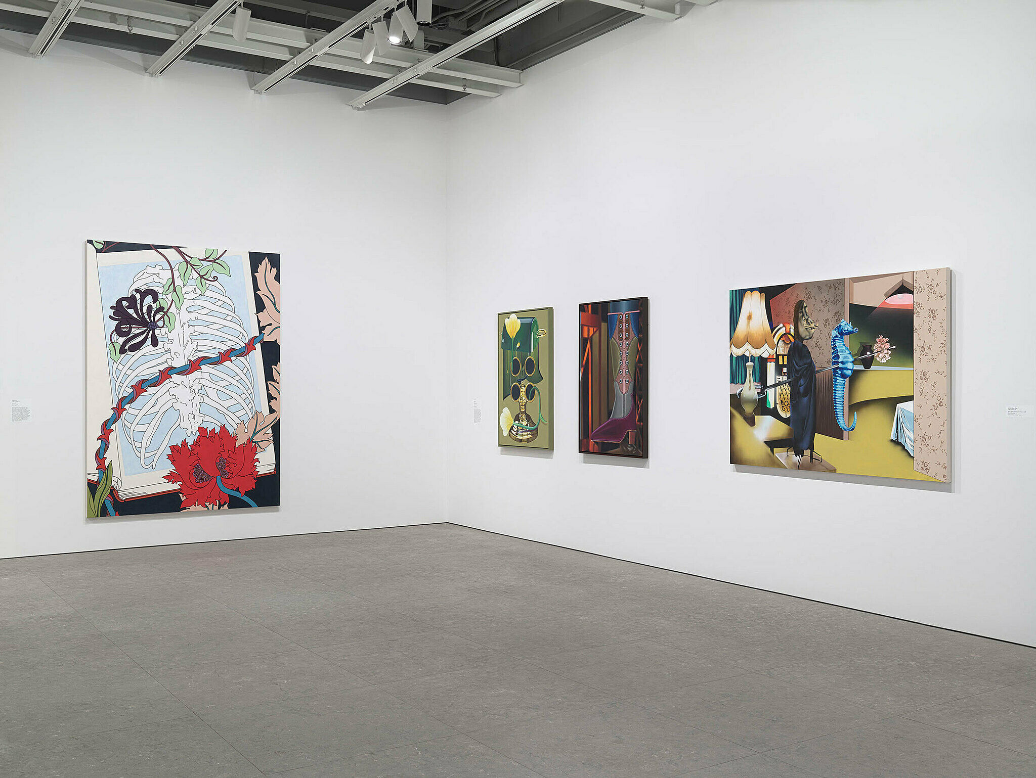 Four paintings on adjacent walls.