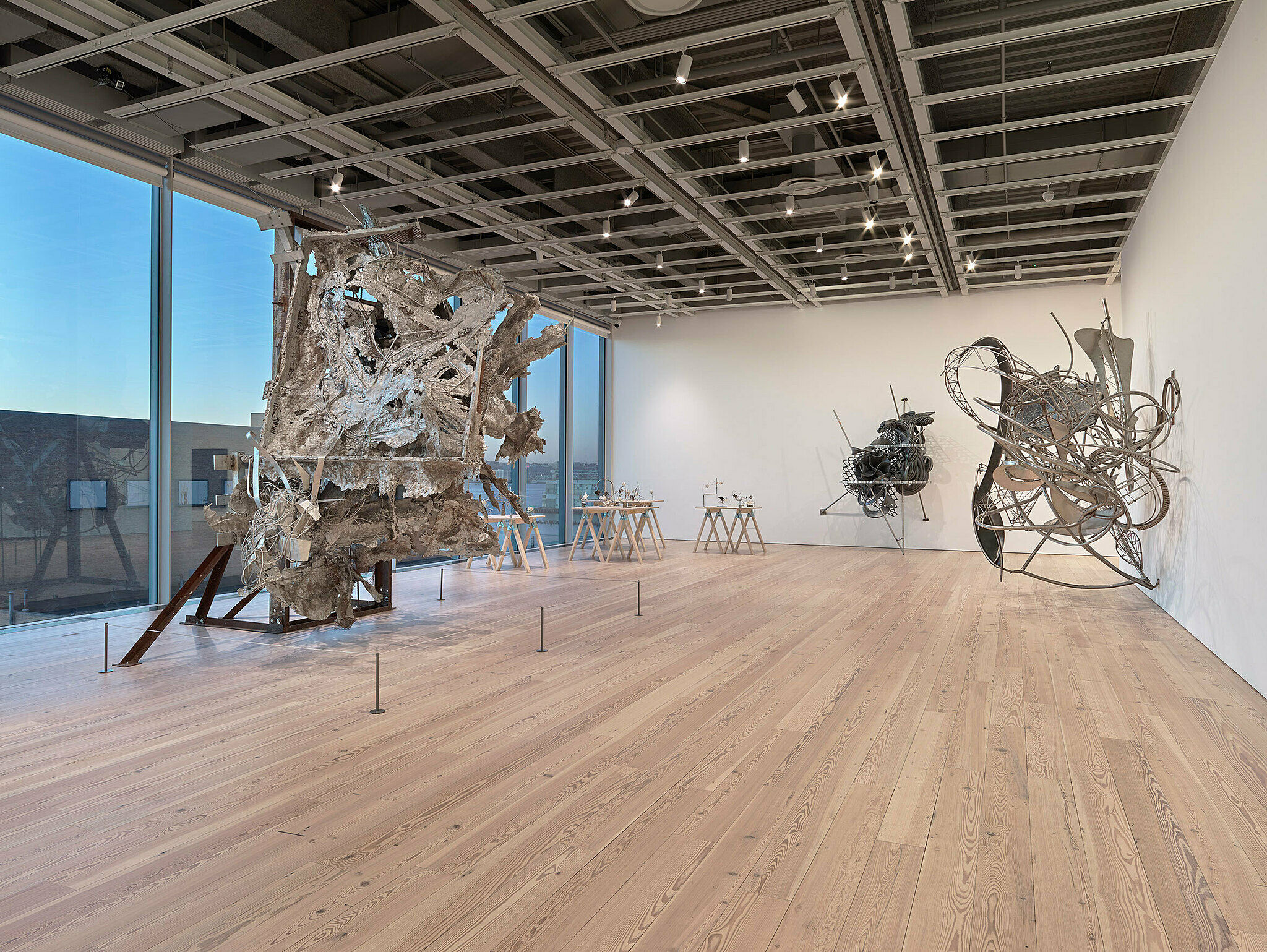 Metal sculptures line the gallery space.