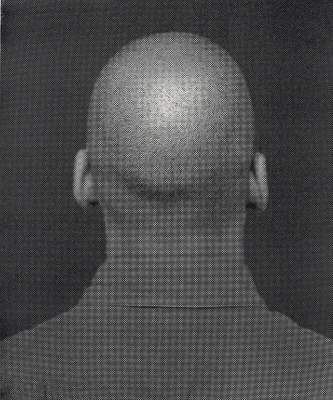 Back of a man's head in black and white.