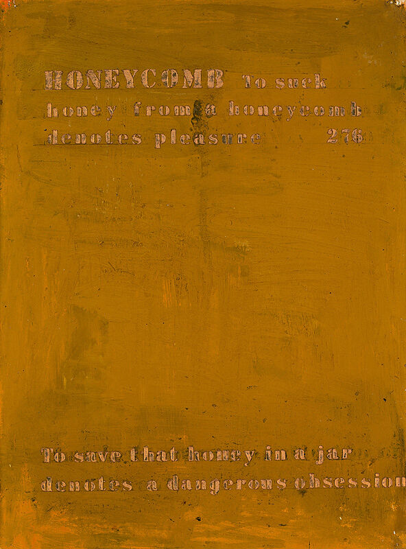 Gold colored painting with writing on it.
