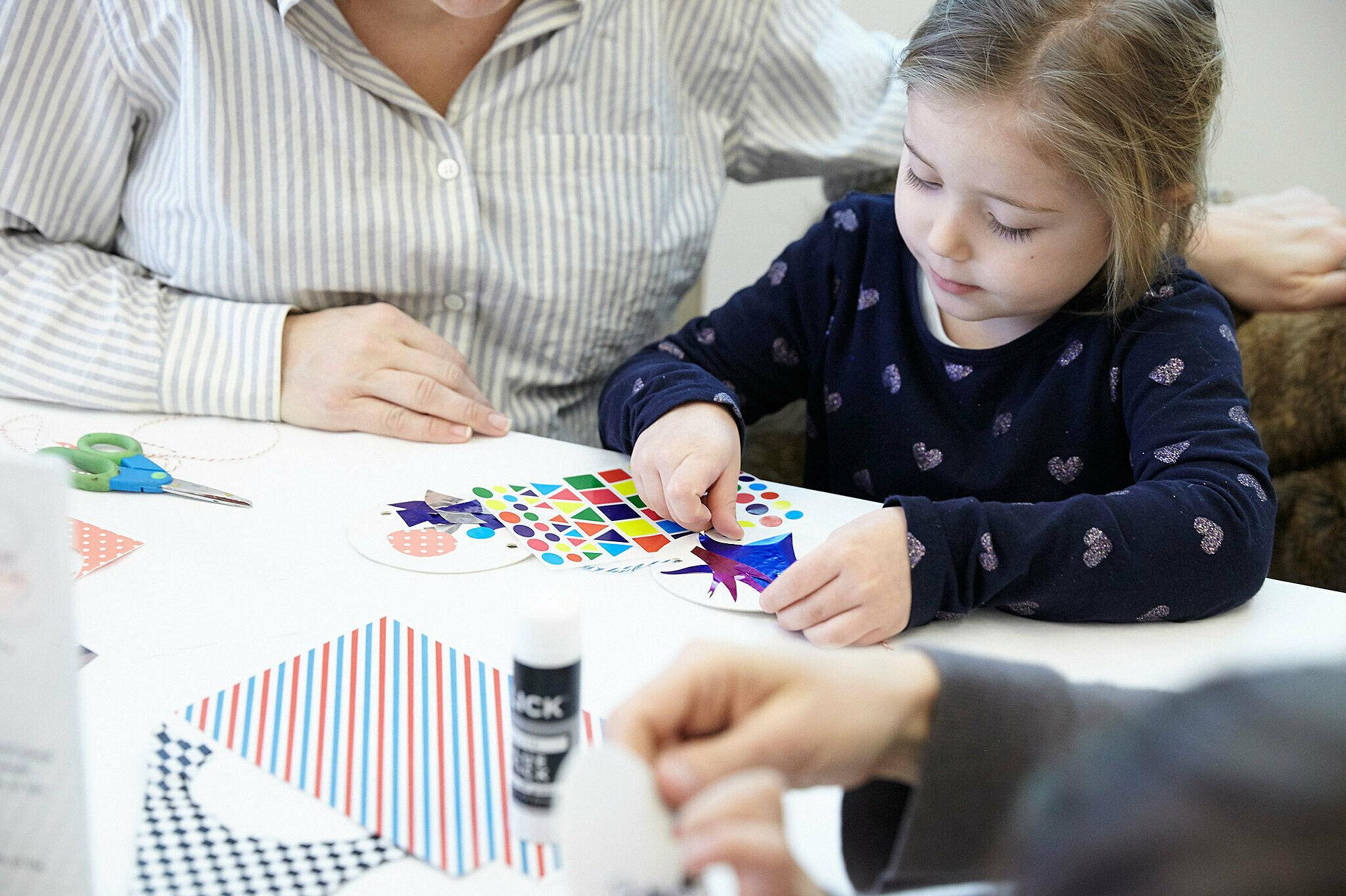 Kids work with art materials