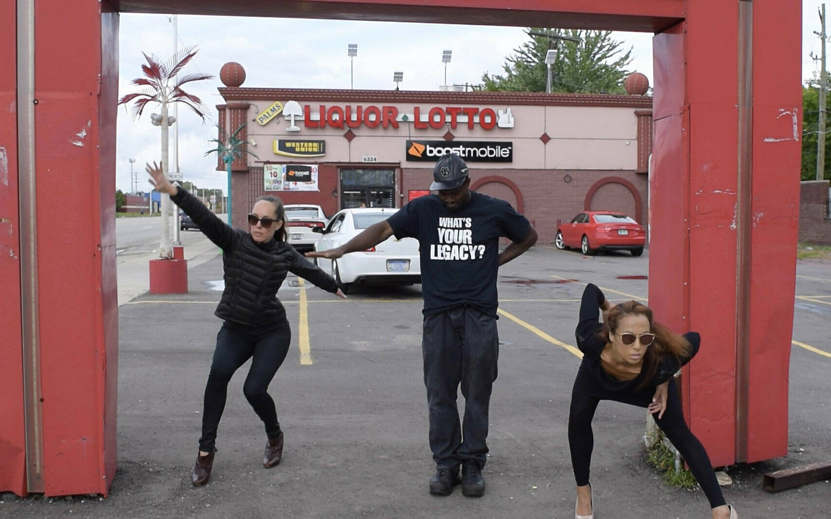 three dancers in liquor store parking lot