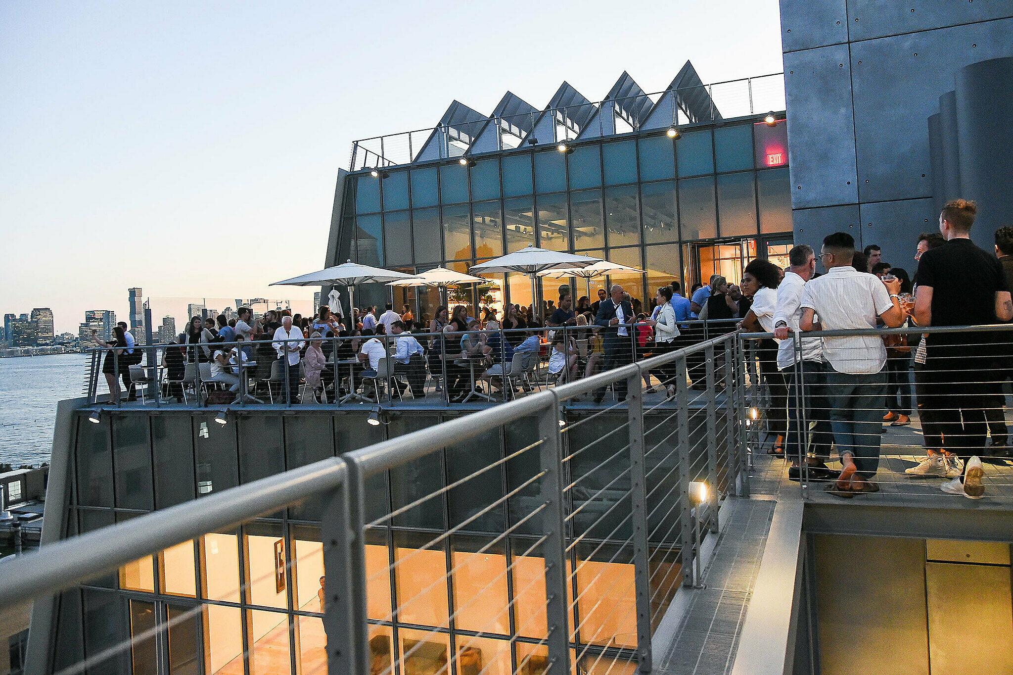 Members enjoy the Whitney Museum's terrace