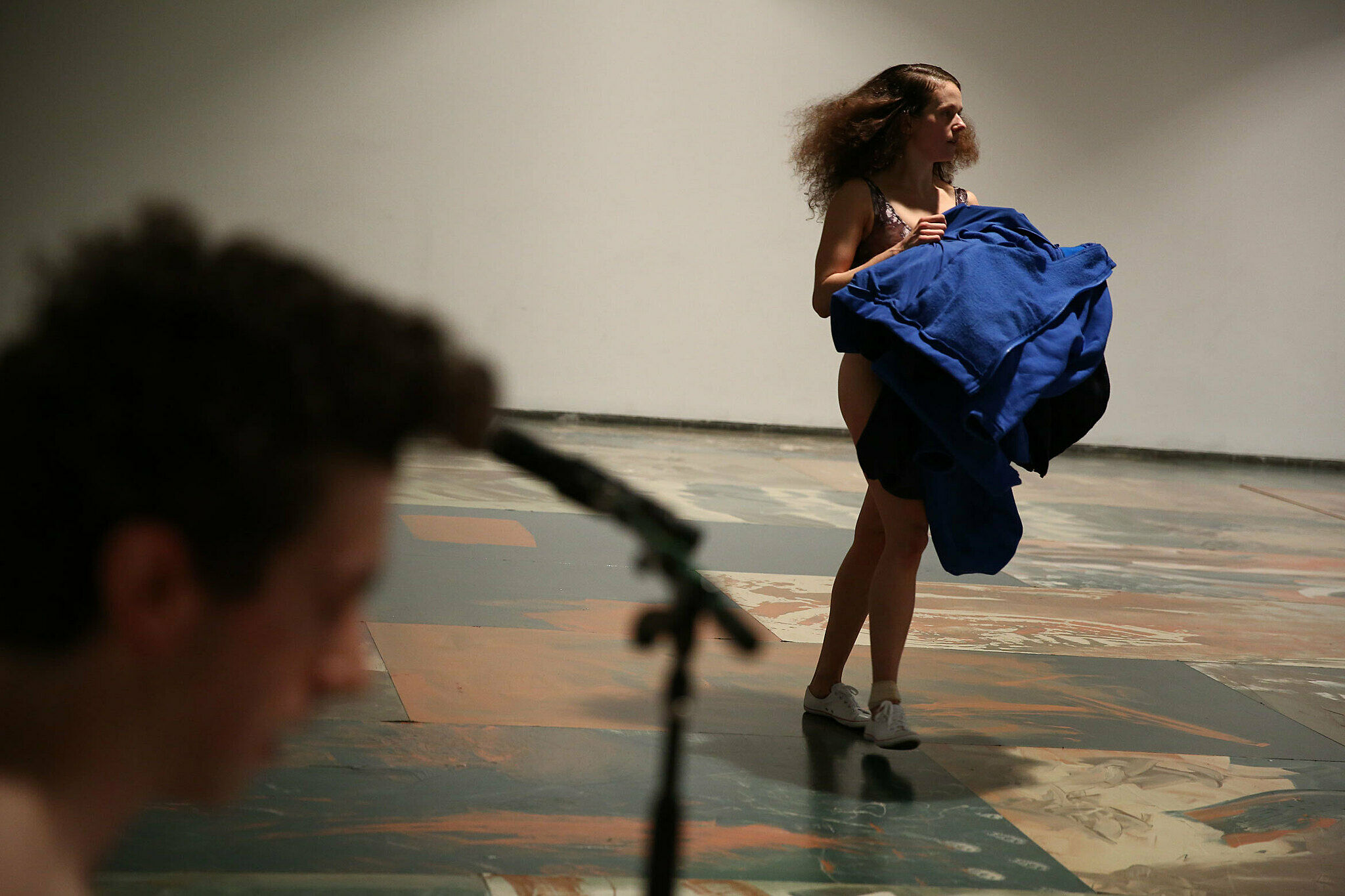A dancer holding a blue outfit.