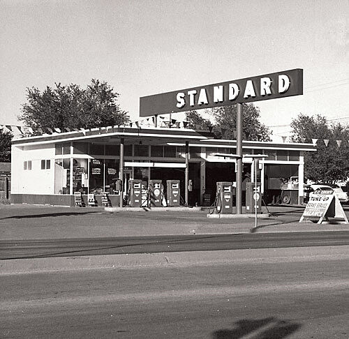 A roadside gas station in black and white.  Photo by Edward Ruscha.