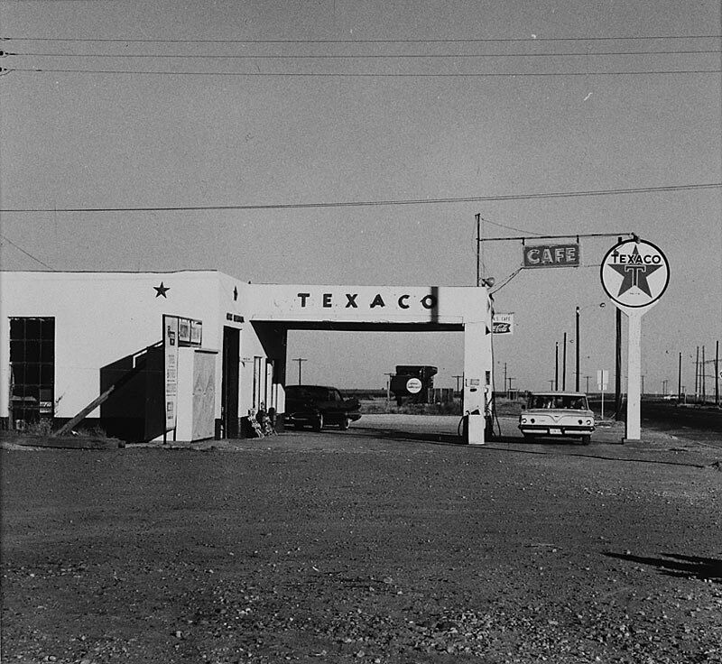 Roadside Texaco gas station with a car parked out front.