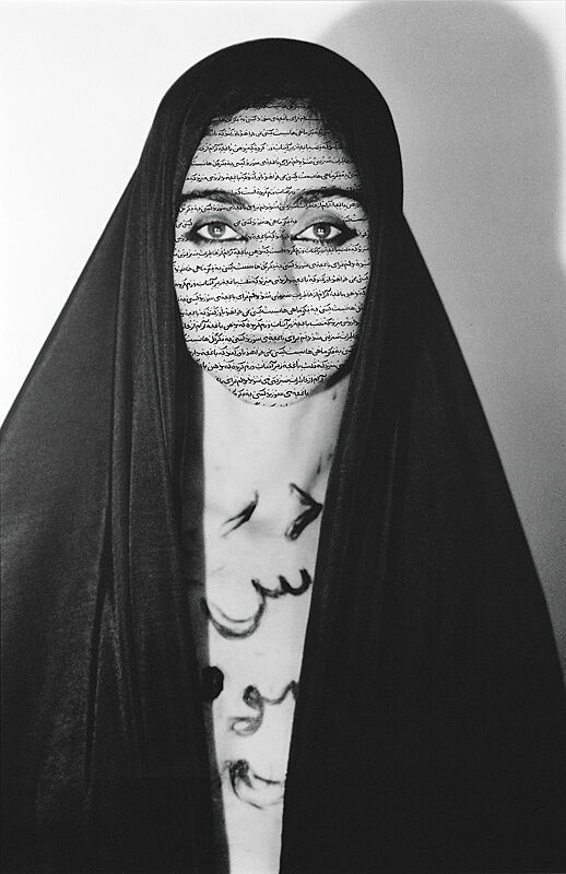 Woman in Hijab with arabic written on her face and body.