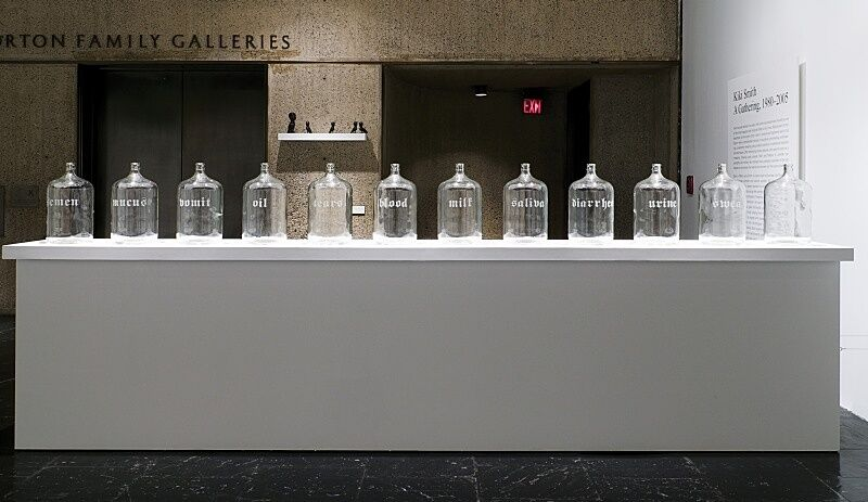 Glass containers sit on a white table.