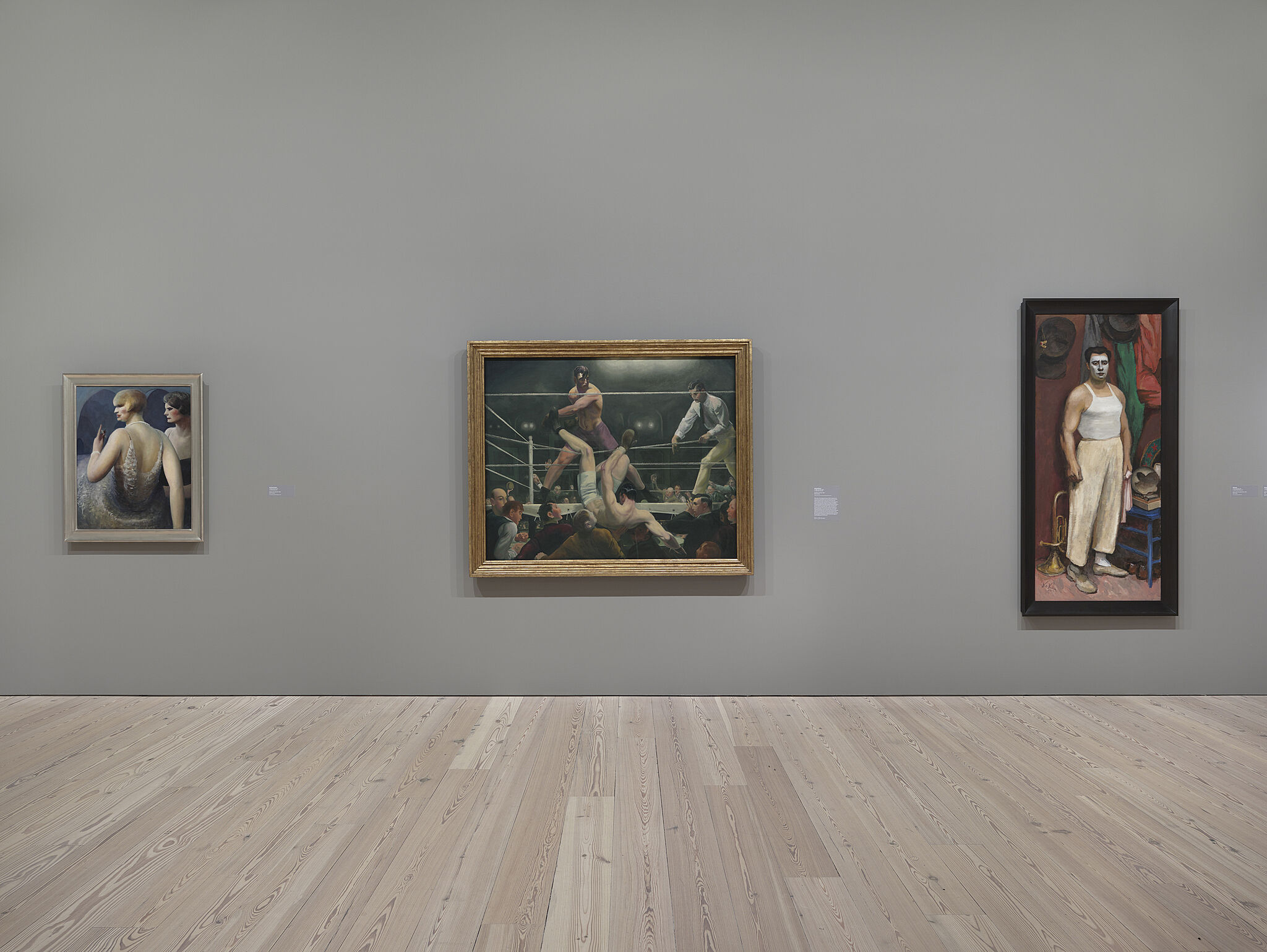Three paintings on the walls of the Whitney.