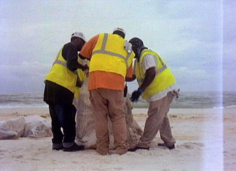 Four men in reflective uniforms working.
