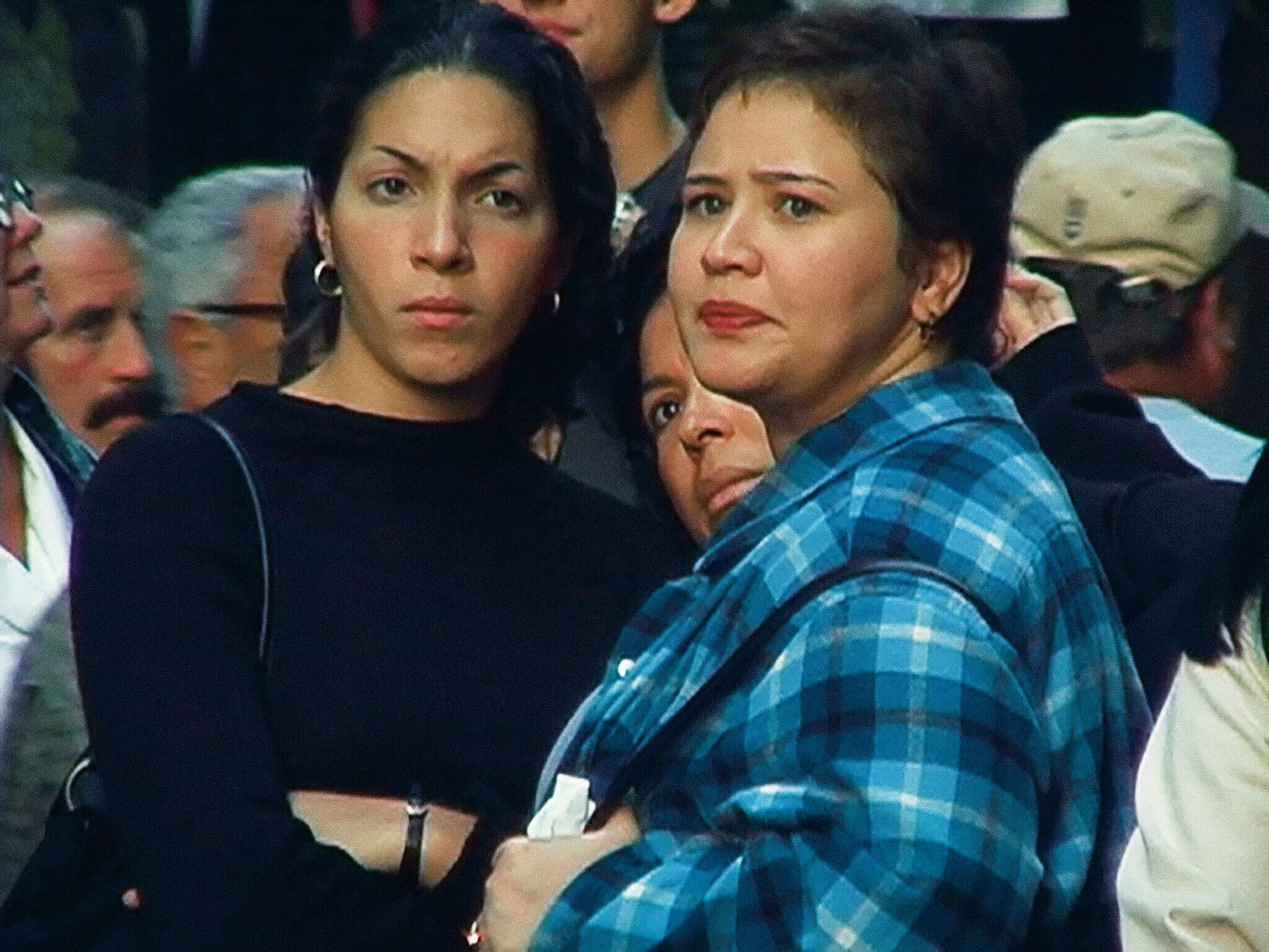 Two women pictured with intense expressions.