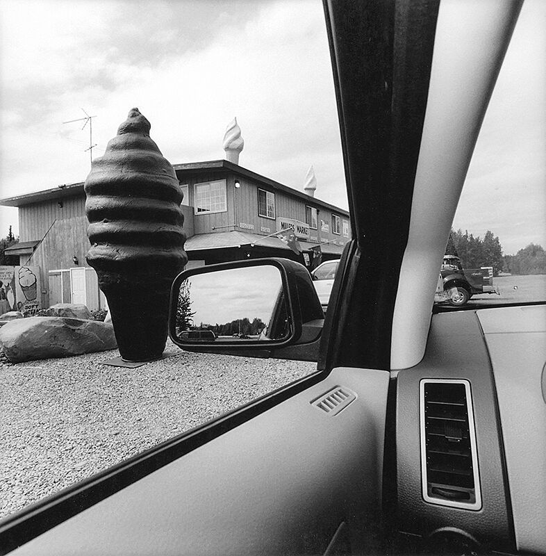 Photo from car of soft serve ice cream sculpture.