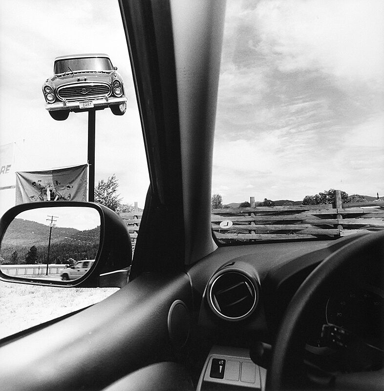 Photo of rustic scene taken from inside of a car.