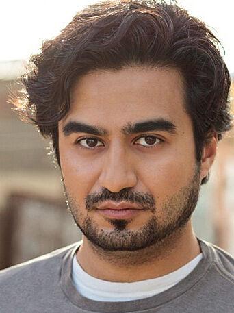 A headshot of actor Fajer al-Kaisi.